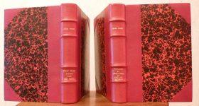 Deux reliures demi-cuir à coins à moitié ouvertes, papier Annonay rouge
