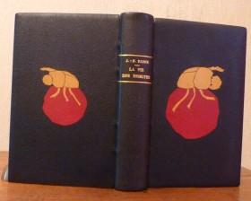Plein cuir bleu nuit plaquage d'un bousier jaune sur une bouse rouge
