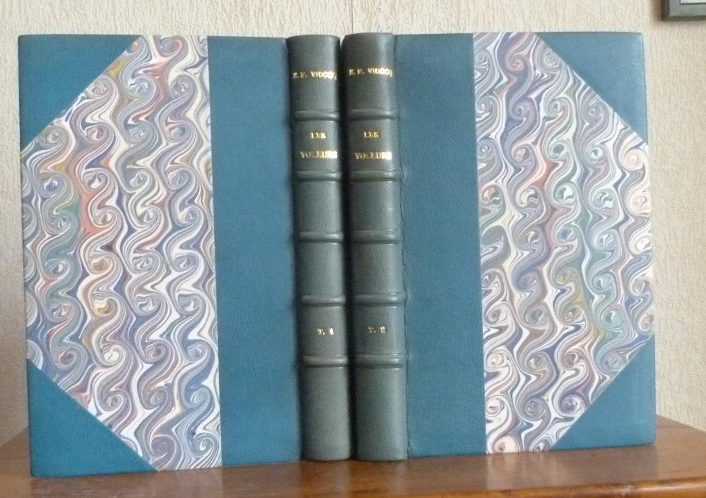 Deux tomes en demi-cuir bleu à coins, tête or