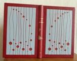 Demi-cuir rouge à encadrements, décor découpée dans une dalle de vinyle grise, tranchefile cuir bicolore rouge et grise,charnière cuir, étui triple.