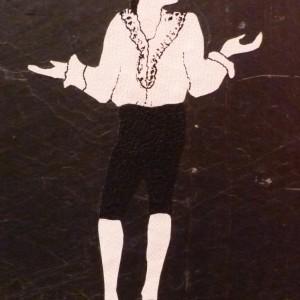 Demi-cuir noir, plats en ardoise, mosaïque en cuir noir et blanc représentant Figaro, 4 nerfs. osa¨que représentant Figaro.