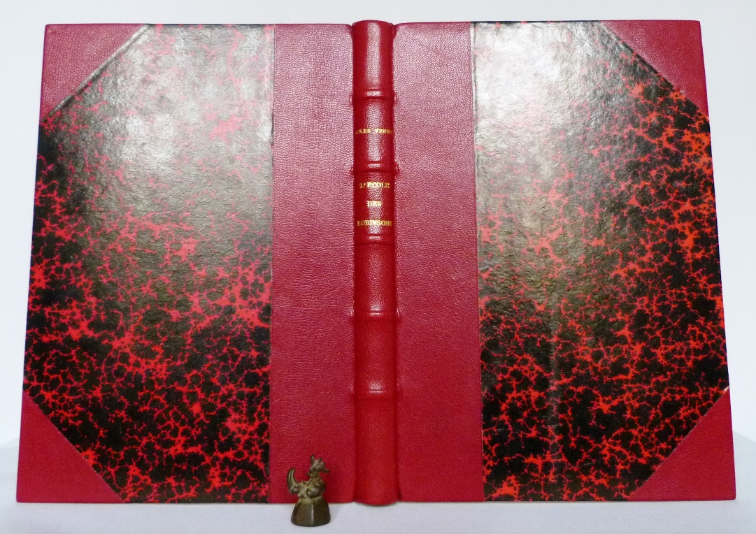 """""""L'école des Robinsons"""" de Jules verne, demi-cuir à coins rouge."""