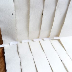 Comblage en queue : feuilles d'un cahier